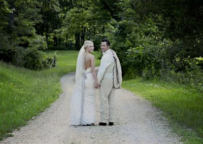 bride and groom on gravel road at Seven T Farms outdoor st louis area wedding venue in sullivan missouri
