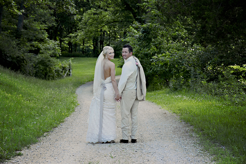 bride and groom on gravel road at Seven T Farms outdoor st louis area wedding venue in sullivan missouri