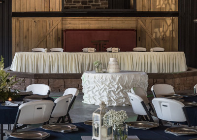 head table and reception area at Seven T Farms outdoor st louis area wedding venue in sullivan missouri
