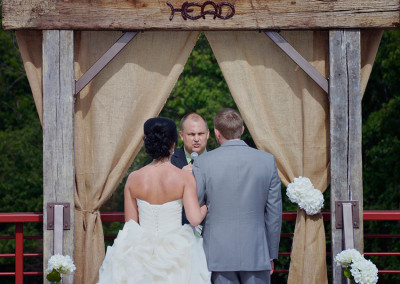 bride and groom at rustic altar at Seven T Farms outdoor st louis area wedding venue in sullivan missouri