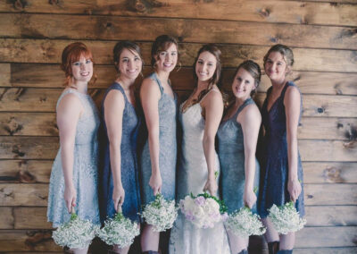 Bridesmaids Posed by Wall - Photo by BGI Photography