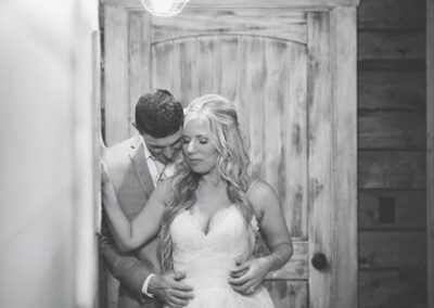 Couple in Front of Rustic Door - Phot by BGI Photography