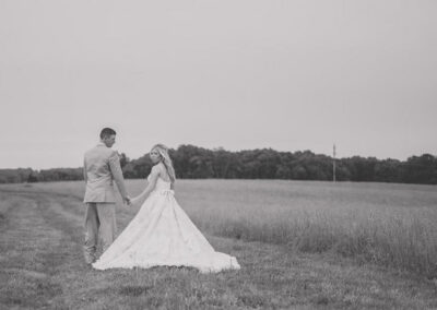 Couple in Field in Black and White - Photo by BGI Photography