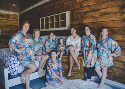 Bridesmaids Gathered on Bed 1