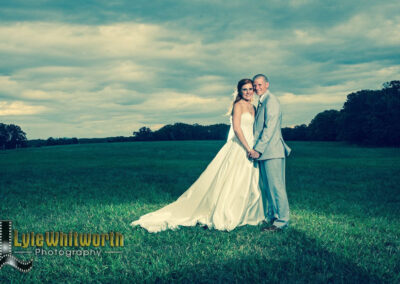 Couple in Field - Photo by Lyle Whitworth